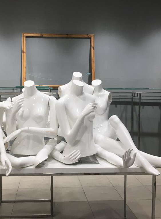 A group of group of undressed mannequins on a table