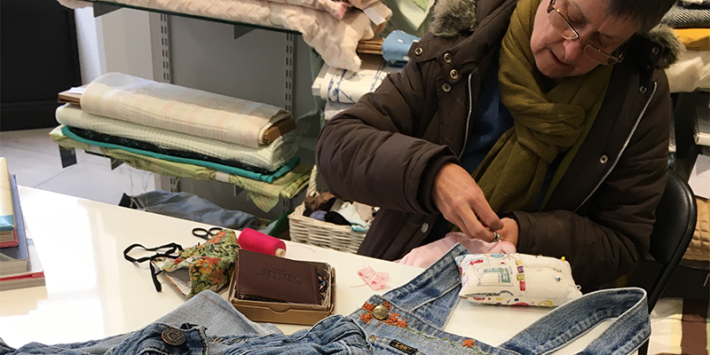 woman repairing a pair of jeans